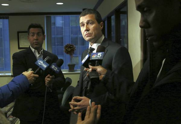 Attorney Antonio Romanucci speaks to reporters Jan. 3 about his client in the Maine West hazing case known as John Doe C, at his law office in Chicago.