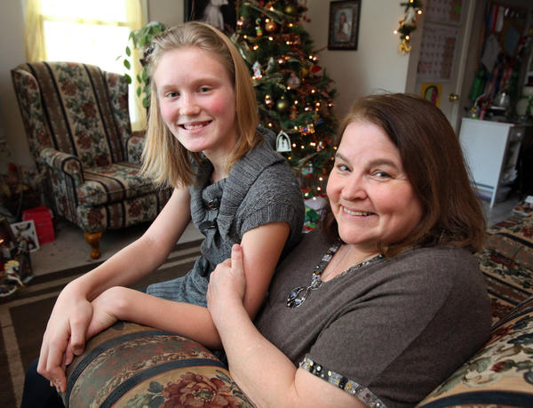 Nancy Cleveland, right, is seen with her daughter Natasha, 11, who Nancy adopted from Russia in 2006.
