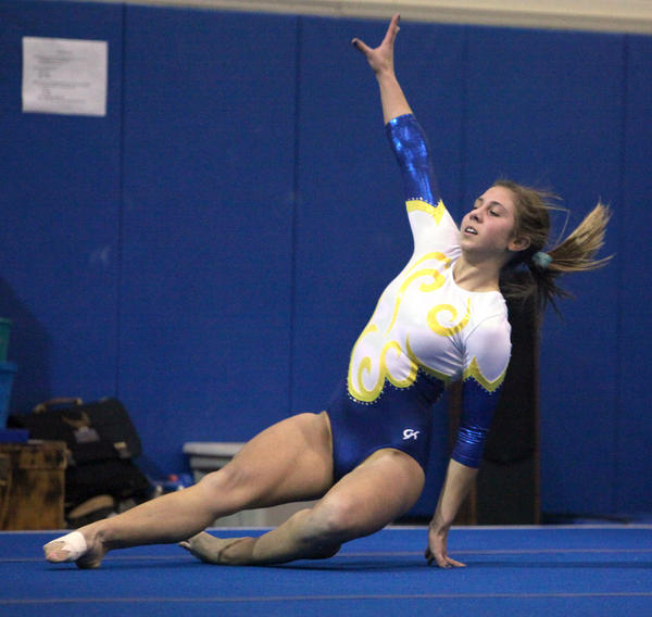 Aberdeen Central's Larissa Swanson performs her floor exercise routine at Thursday's gymnastics triangular in the Aberdeen Central High School auxiliary gym.