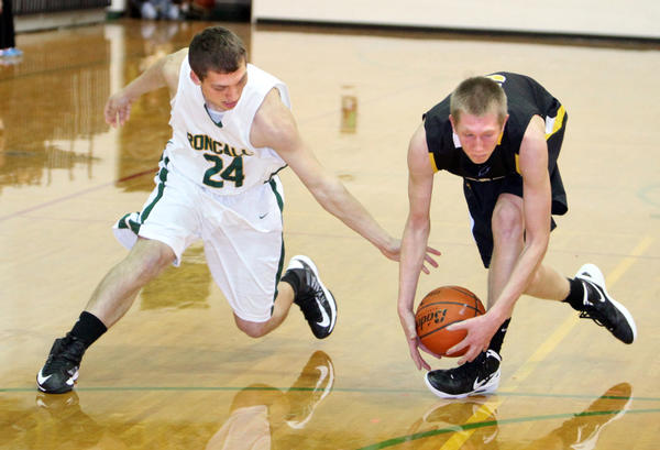 Groton's Mason Madsen, right, steals the ball from Aberdeen Roncalli's Lucas Lorenz, left. during Thursday night's game at the Roncalli High School gym.