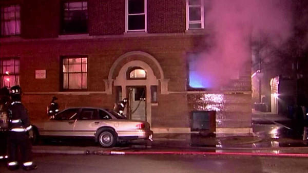 Two police officers rescued residents of this building early on Jan. 4.