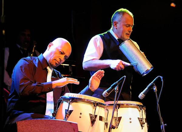 Hector Rosado plays the congas along with the Hector Rosado's Orchestra as they perform during Salsa night at the Musikfest Cafe, ArtsQuest Center at SteelStacks in Bethlehem.