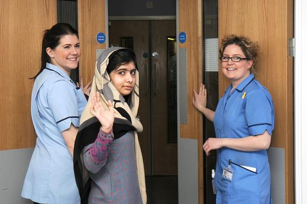 Pakistani schoolgirl Malala Yousufzai waves with nurses as she is discharged from The Queen Elizabeth Hospital in Birmingham in this handout photograph released on January 4, 2013. The Pakistani girl shot in the head by the Taliban for advocating girls' education has been discharged from the specialist British hospital after doctors said she was well enough to spend some time recovering with her family.