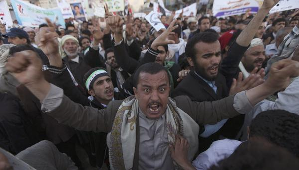 Pro-democracy protesters shout slogans during a demonstration, demanding a quicker implementation of President Abd Rabbo Mansour Hadi's latest orders to restructure the Yemeni army units, in Sanaa, January 3, 2013.