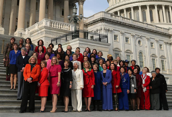 WASHINGTON, DC - JANUARY 03: Democratic Leader Nancy Pelosi (D-CA) (C), stands with the Democratic women of the House to highlight the historic diversity of the House Democratic Caucus, on January 3, 2013 in Washington, DC
