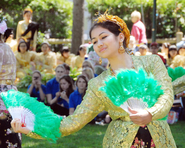 """Nik"" Chompoonik,  a member of the Wattana Girls Chorus, of Bangkok, Thailand, performs a traditional Thai dance in Petoskey's Pennsylvania Park on June 25. The Thai dancers and singers are part of the Voices Without Borders Children of the World in Harmony International Youth Choir and Dance Festival performing throughout the area."