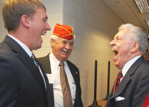 "U.S. Marine Corps veteran and Medal of Honor recipient Sgt. Dakota Meyer, (left) and World War II U.S. Marine Corps veteran and Iwo Jima survivor, Hank Ameel, (right) of Petoskey, share an ""Oorah"" moment while meeting each other prior to Meyer's speech, Wednesday evening at North Central Michigan College. Looking on is Emmet County Veterans Affairs officer and Marine Corps veteran Jim Alton (center) of Petoskey."