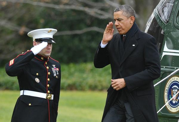 President Barack Obama steps off Marine One on the South Lawn of the White House on Thursday as he returned early from a family vacation in Hawaii to attend to negotiations over the impending fiscal cliff.