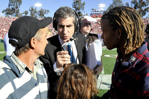 Game manager Ted Tompkins instructs friends of Jane Goodall about what they will be doing at the 99th Rose Bowl in Pasadena on Tuesday, January 1, 2013.