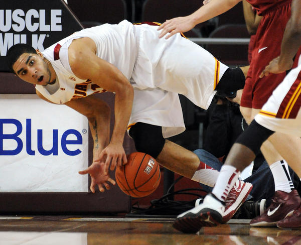USC Trojans forward Aaron Fuller (L) goes for a loose ball during the first half of the game against the Stanford Cardinal.