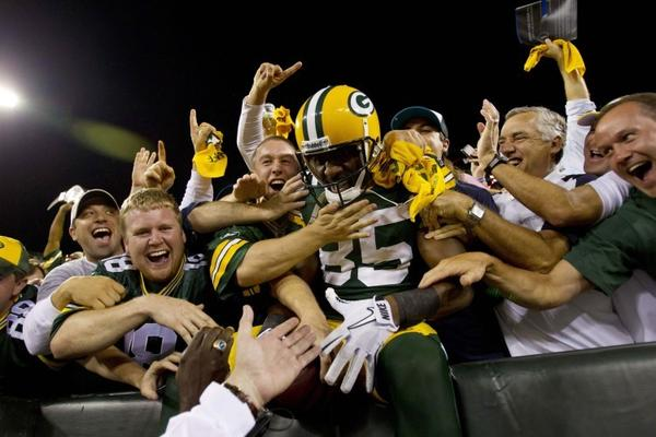 Sep 8, 2011; Green Bay, WI, USA; Green Bay Packers wide receiver Greg Jennings (85) celebrates a touchdown during the first quarter against the New Orleans Saints at Lambeau Field.  Mandatory Credit: Jeff Hanisch-US PRESSWIRE