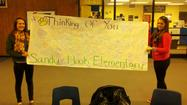 Photos: NW Students make banner for Sandy Hook Elementary