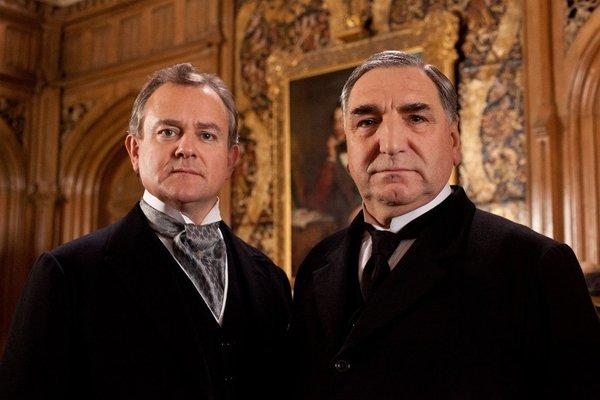 "Hugh Bonneville as Lord Grantham, left, and Jim Carter as his butler, Carson, on ""Downton Abbey."""
