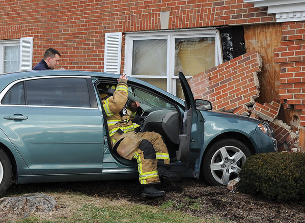 Medical personal from Winchester Fire-EMS check on the driver of a vehicle that crashed into the medical building at 1109 McCann Drive Friday afternoon. The driver of the vehicle was transported to Clark Regional Medical Center for medical treatment. The crash collapsed a section of the brick wall where the waiting room is located for Premier Eye Care. No one in the waiting room was injured.