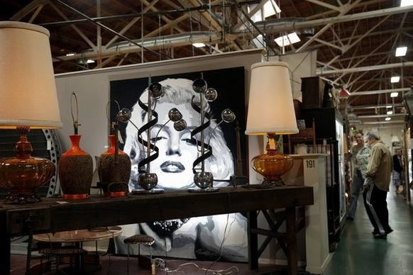 An oversized painting of Marilyn Monroe looms over an antiques booth at the Wertz Bros., which is set to close Feb. 1.
