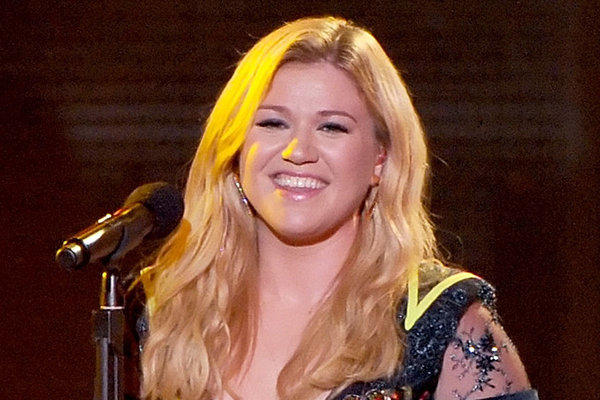 "Kelly Clarkson, shown during a performance on the 2012 edition of ""VH1 Divas,"" has responded to rumors than she is gay."