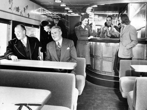 The Chicago North Shore and Milwaukee Railroad introduced the luxurious Electroliner in 1941, complete with a tap room car and speeds of 85 miles an hour. Looking over the new equipment are Col. A. A. Sprague, left, and Bernard J. Fallon, Chief Executive Officer, on Jan. 25, 1941.