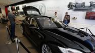 Tesla Motors won its latest round in a battle against auto dealers and their associations that want to prevent the upstart electric car company from opening its own stores.