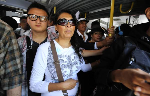 Xochitl Barcenas and her son Aldo, ride on a crowded city bus to downtown Mexico City. The family was on a weekend excursion to visit museums and tourist attractions in the historic district of the city.