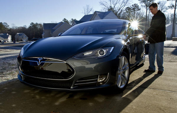"Todd Burch enters his new car at his Smithfield home.  Todd Burch is the first person in Tidewater and the 3rd person in Virginia ""he said"" to get a rare Tesla electric car."