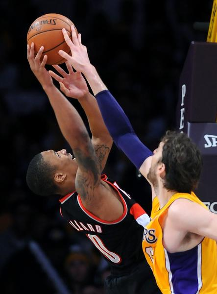 Pau Gasol blocks Blazers guard Damian Lillard's shot.