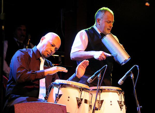 Hector Rosado plays the congas along with the Hector Rosado's Orchestra as they perform during Salsa night at the Musikfest Cafe, ArtsQuest Center at SteelStacks in Bethlehem Friday night.