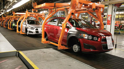 Chevrolet Sonics move down the line at the General Motors Orion Assembly Plant in Orion Township, Mich., on April 25.