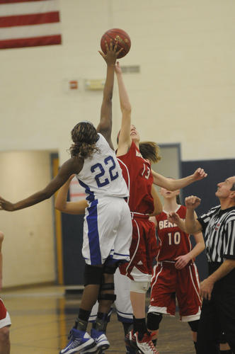 Daijia Brooks for Bristol Eastern, left, and Berlin's Paige Young start the game with the tip at Bristol Eastern High Friday night.