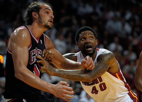 Miami Heat forward Udonis Haslem tries to position himself for a rebound against Chicago Bulls center Joakim Noah during the first half of their game, Friday, January 4, 2013, at AmericanAirlines Arena.