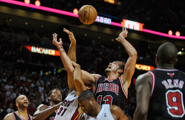 Chicago Bulls center Joakim Noah battles Miami Heat forward Shane Battier for a rebound during the first half of their game, Friday, January 4, 2013, at AmericanAirlines Arena.