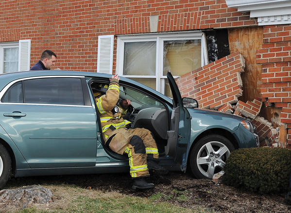 Medical personnel from Winchester Fire-EMS check on the driver of a vehicle that crashed into the medical building at 1109 McCann Drive Friday afternoon. The driver of the vehicle was transported to Clark Regional Medical Center for treatment. The crash collapsed a section of the brick wall where the waiting room is located for Premier Eye Care. No one in the waiting room was injured.