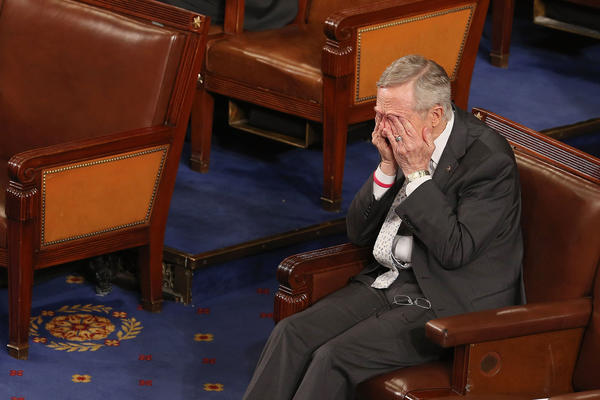 Senate Majority Leader Harry Reid (D-NV) rubs his eyes during the counting of the Electorial College votes from the 50 states in the House of Representatives chamber at the U.S. Captiol January 4, 2013 in Washington, DC. The votes were tallied during a joint session of the 113th Congress. President Barack Obama and Vice President Joe Biden received 332 votes to be reelected.