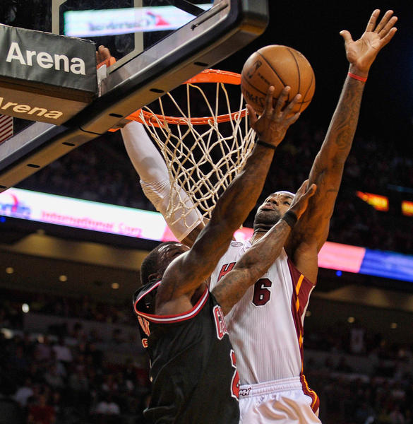 Miami Heat forward LeBron James blocks the layup of Chicago Bulls guard Nate Robinson during the second half of their game, Friday, January 4, 2013, at AmericanAirlines Arena.