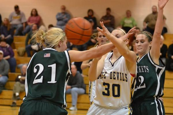Greencastle-Antrim's Katie Gelsinger (30) attempts to get the ball out of the key during the third quarter of Friday night's game against James Buchanan.