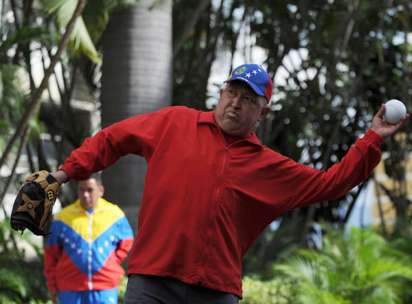 Venezuelan President Hugo Chavez tosses a baseball at the presidential palace Miraflores in Caracas on Sept. 29, 2011. Chavez had denied a report that his health was declining, telling Venezuelans he was 'doing well' as he recovered from cancer-fighting chemotherapy.