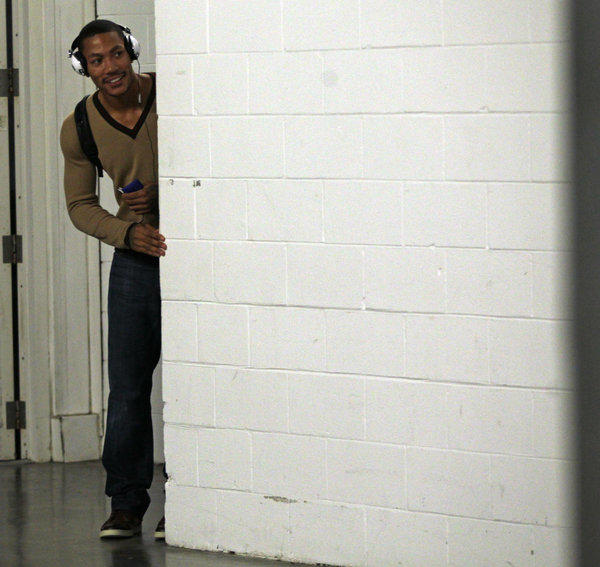 Derrick Rose peeks around the corner after Bulls' 96-89 win over the Heat at American Airlines' Arena in Miami.