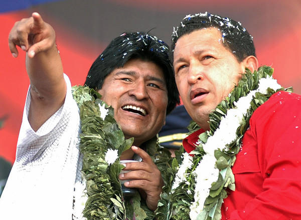 Venezuelan President Hugo Chavez, right, stands with President of Bolivia Evo Morales at the signing of an agreement to create a thermoelectric station in the Bolivian region of Chapare, on Aug. 10, 2007.