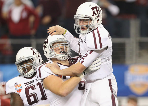 Johnny Manziel (#2) of the Texas A&M Aggies celebrates his touchdown against the Oklahoma Sooners during the Cotton Bowl at Cowboys Stadium on Jan.4, 2013 in Arlington, Texas. The Aggies beat the Sooners 41-13.