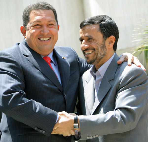 "Venezuelan President Hugo Chavez shakes hands with Iranian President Mahmoud Ahmadinejad in Tehran on July 1, 2007. At the time, Chavez referred to Ahmadinejad as his ""ideological brother""."