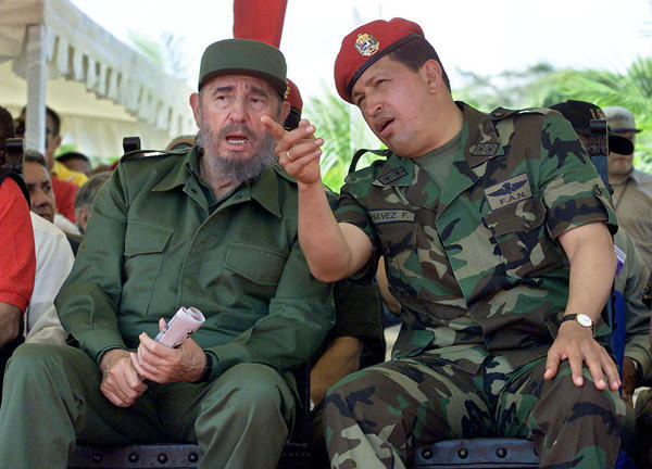 Venezuelan President Hugo Chavez, right, confers with Cuban President Fidel Castro on Dec. 11, 2001 in Pampatar, Venezuela.