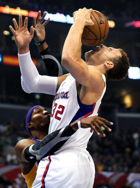 Clippers forward Blake Griffin is fouled by Lakers' Dwight Howard.