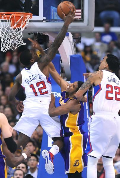 Lakers guard Darius Morris has his shot blocked by Clippers guard Eric Bledsoe.