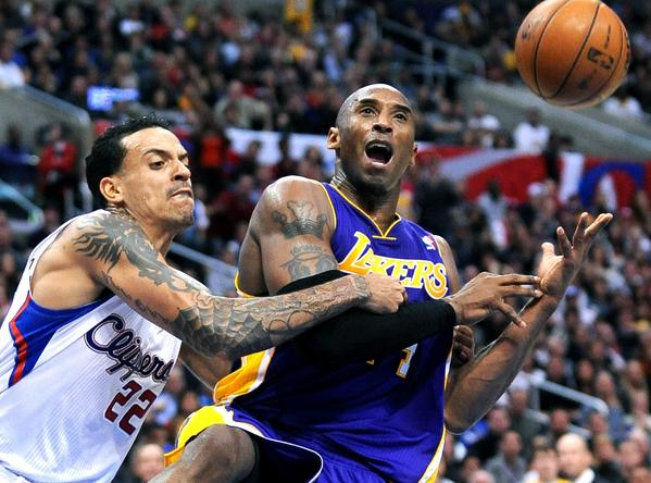 Lakers guard Kobe Bryant is fouled by Clippers' Matt Barnes while driving to the basket.