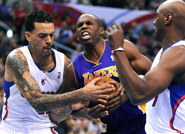 Clippers forward Matt Barnes, left, forces Lakers guard Jodie Meeks into a jump ball.