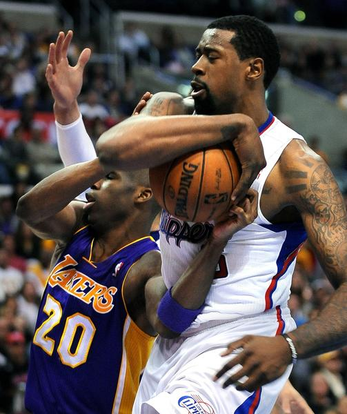 Clippers center DeAndre Jordan grabs the ball away from Lakers guard Jodie Meeks, but is called for a foul.