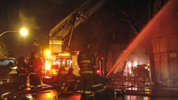 Firefighters apply water to a 3-story 6-flat apartment building in the 4000 block of West Wilcox late on Jan. 4, 2013.