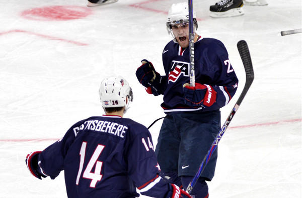 American Rocco Grimaldi celebrates his first goal against Sweden with teammate Shayne Gostisbehere in the second period Saturday.