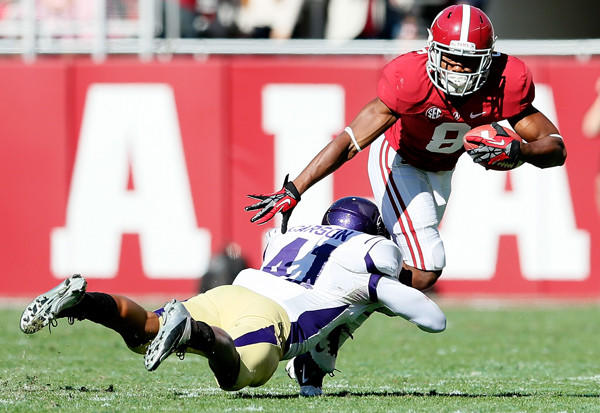Alabama's Cyrus Jones, right, looks to escape the tackle of Western Carolina's Courtland Carson during a game in November.