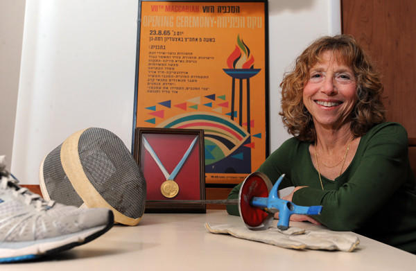 Carol Benjamin, 67, will be competing in the 2013 Maccabiah Games, 48 years after she won a gold medal in women's individual foil during the 1965 games.