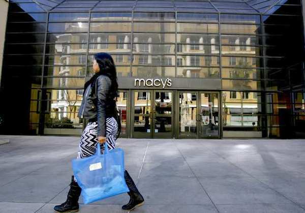 A shopper goes past the entrance of the Paseo Colorado Macy's Store on E. Colorado Blvd. in Pasadena. The store will close in the near future but the nearby Macy's on S. Lake Ave. will remain open.